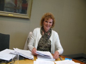 Futures for Women Secretary, Jane Hampson, sorting through applications for loans.