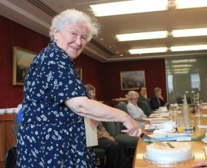 Gillis Burgess cuts her farewell cake.